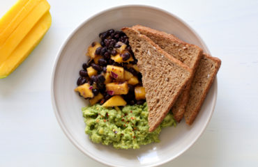 Breakfast toast with avocado and bean salsa